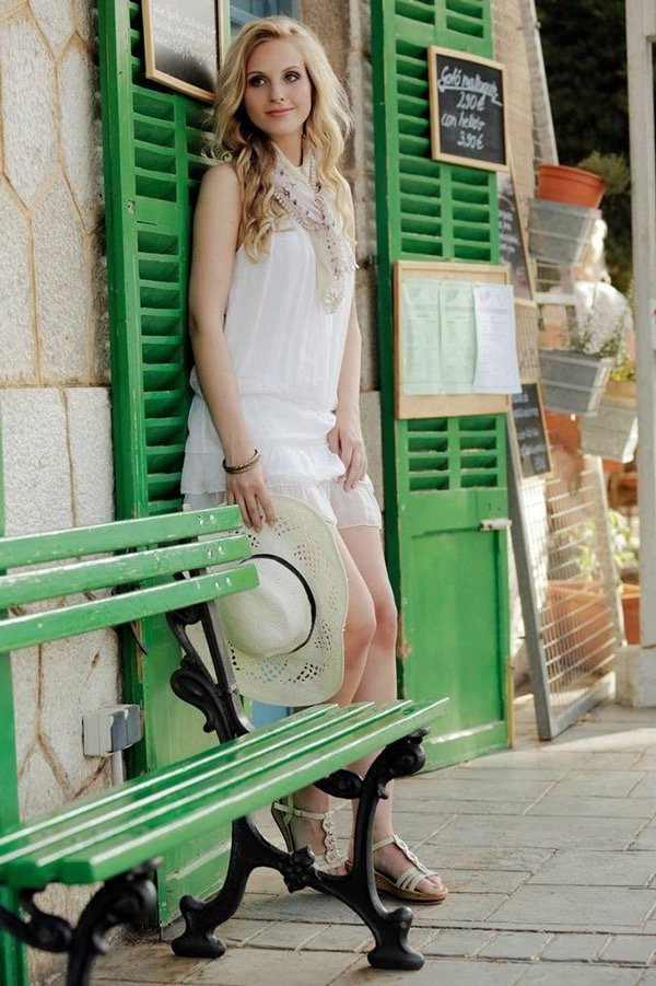 Make up and hair,  blond girl waiting for the train, Mallorca Spain