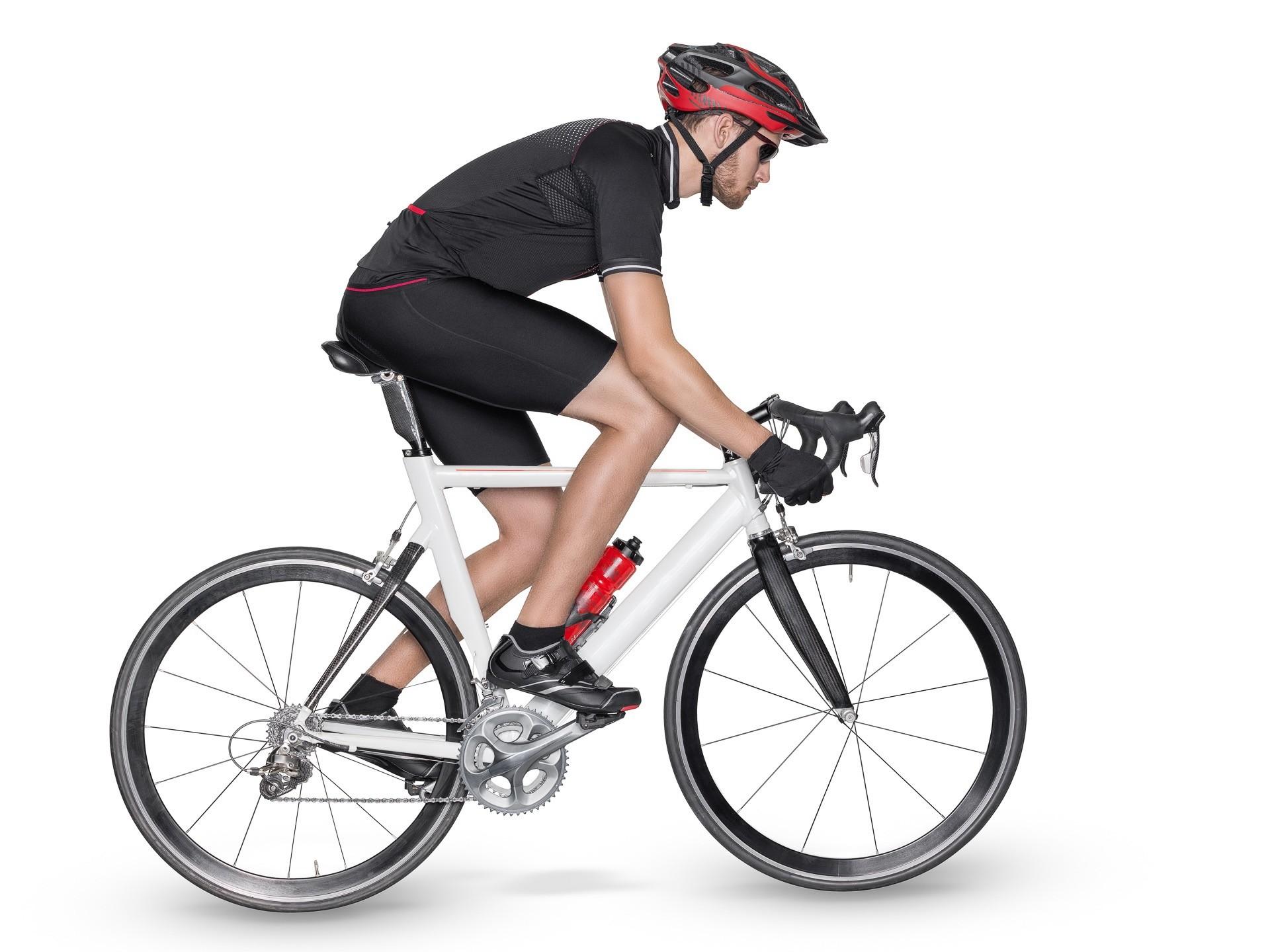 Make up Artist Sportfotos, Radfahrer in schwarz auf weissem Fahrrad